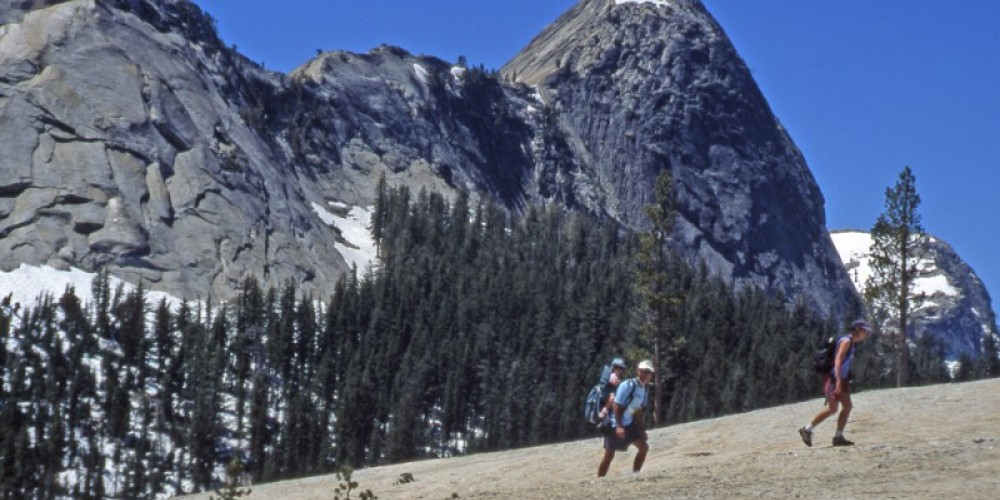Hikers going up Pothole Dome with baby back pack. – Ray Anderson