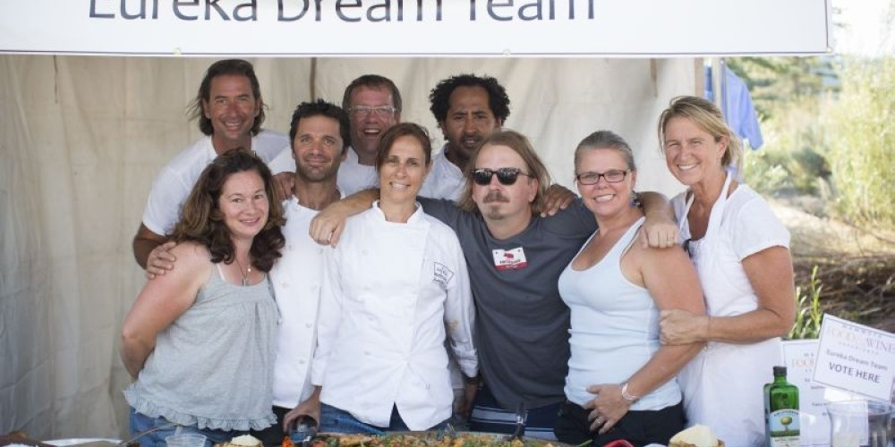 """The reunited """"Dream Team"""" of professional chefs who all started at Wolfgang Puck's Eureka Restaurant, show off their paella at the Outdoor Cooking Competition. – Minaret Photography"""