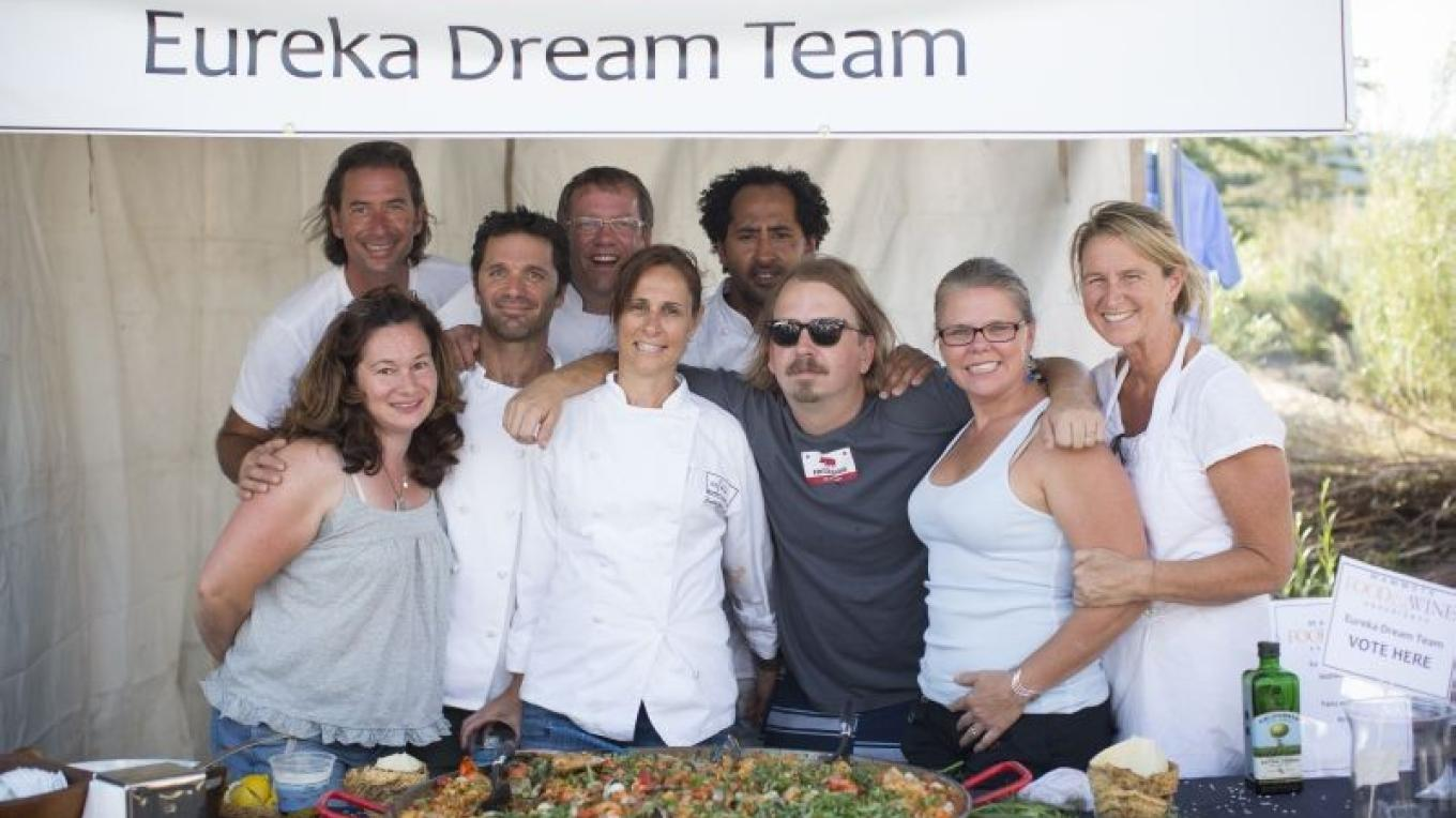 "The reunited ""Dream Team"" of professional chefs who all started at Wolfgang Puck's Eureka Restaurant, show off their paella at the Outdoor Cooking Competition. – Minaret Photography"
