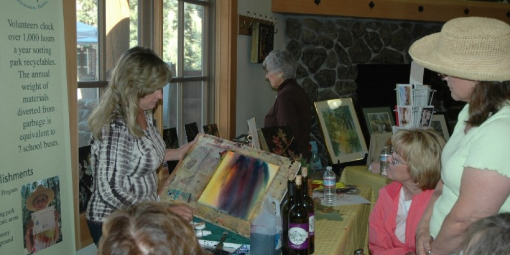 A local artists demonstrates her techniques to a group of women – NPS Photo