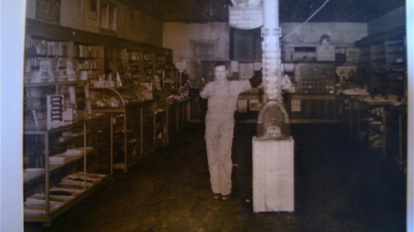 An early photograph of business in the building. Filled with merchandize as The Kitchen Store is today! – Karrie Lindsay