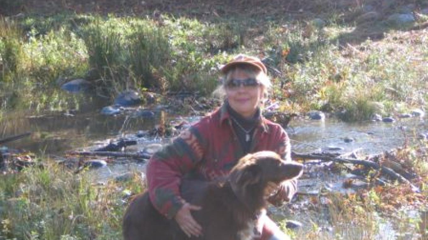 Jenny Cavaliere with her full time companion, Copper. This site on Oregon House farms was part of a riparian restoration project granted through Cal Fire(CFIP). – ED Crans