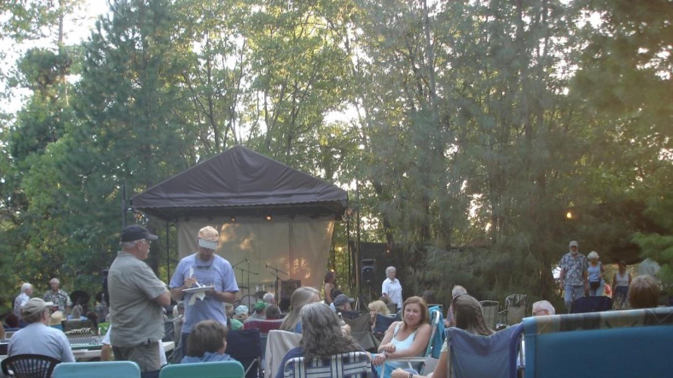 Neighbors and Friends catch up before the music starts on the stage at Grey Pine Farm. – Ben Miles