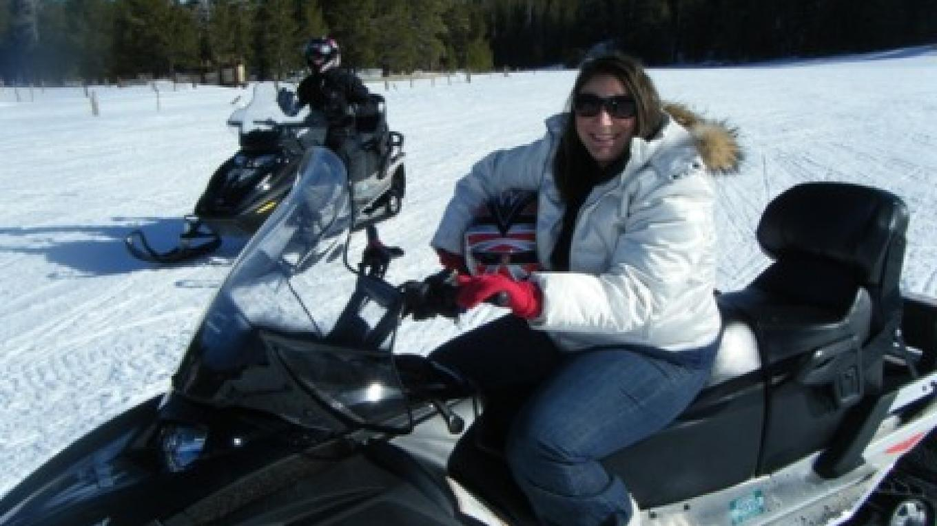 The ladies love riding the quieter, 4 stroke machines that help them see more wildlife. – Eagle Ridge Snowmobiling