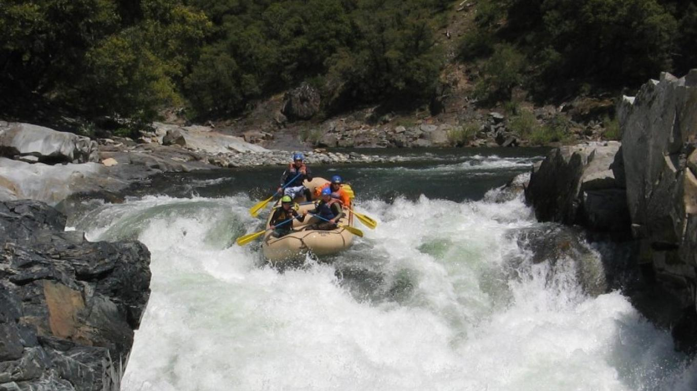 "Rafting on the North Yuiba River through the ""Maytag"" Class 5 rapid. – Graham Morey"