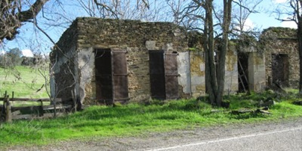 Some of the remaining buildings of the once buslting mining camp – Waymarking.com