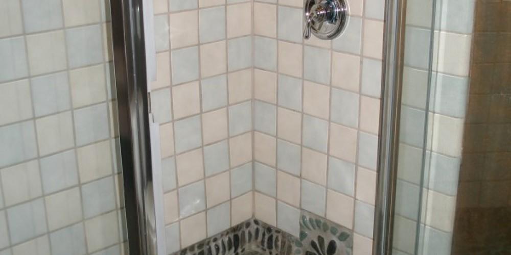 Columbine Cottage's Inlaid Stone Mosaic Shower