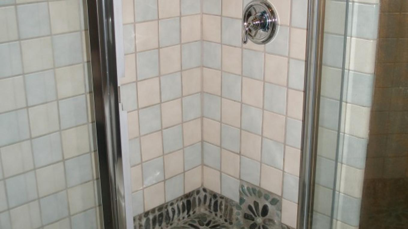 Columbine Cottage's Inlaid Stone Mosaic Shower
