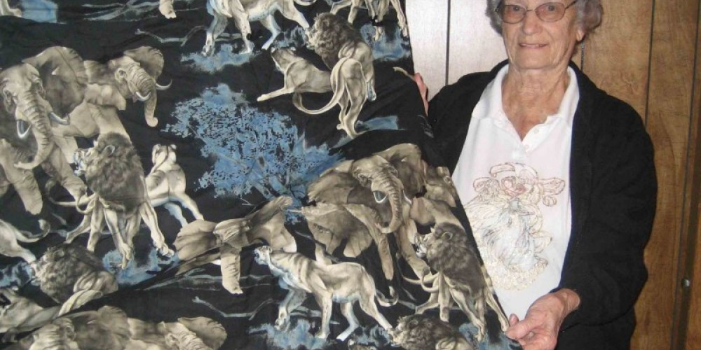 Barbara Wilson shows off one of her quillos (pillow and quilt combination) – Beryl Moody