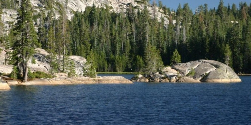Majestic granite mountains and boulders surround the georgous blue of the Lake. It is refreshingly calm and quiet and every turn of the canoe is inspiring and another great picture. – Henriette Frisbie