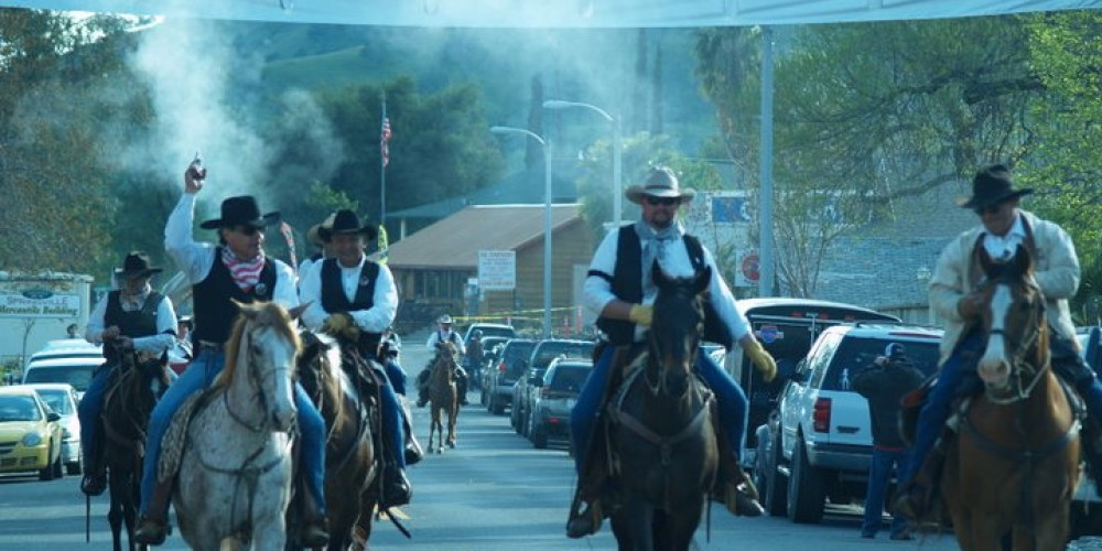 The Jackass Mail Wagon rides into town amid gunfire from all directions as the Springville bandits attempt to steal the mail. – Joyce Eisenberry