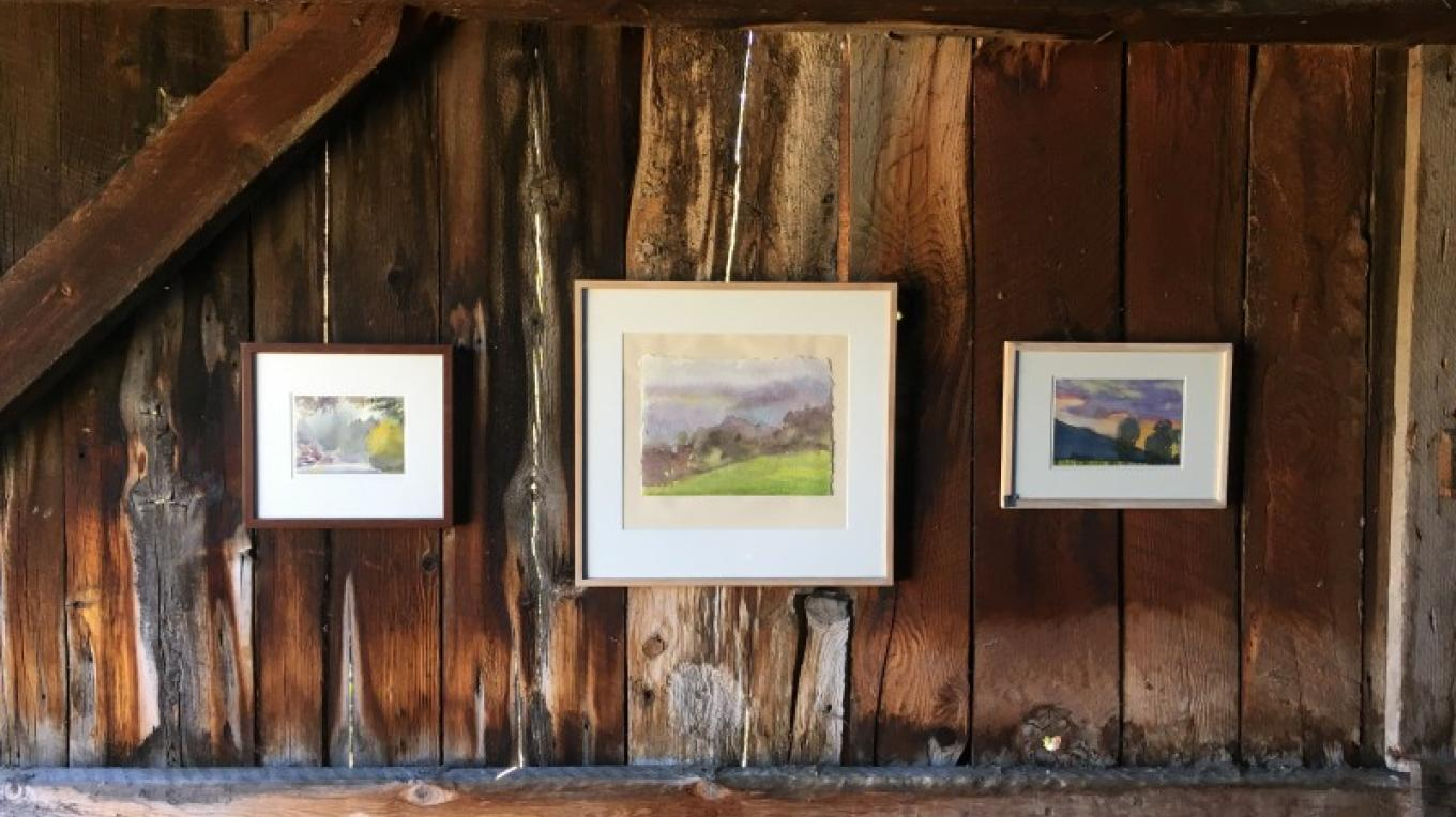Paintings by Joanne Corso, hung on a barn wall near Sierraville.