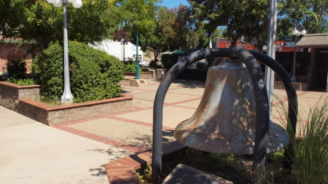 Old Firemen's Bell in Petkovich Park at south end of downtown Jackson