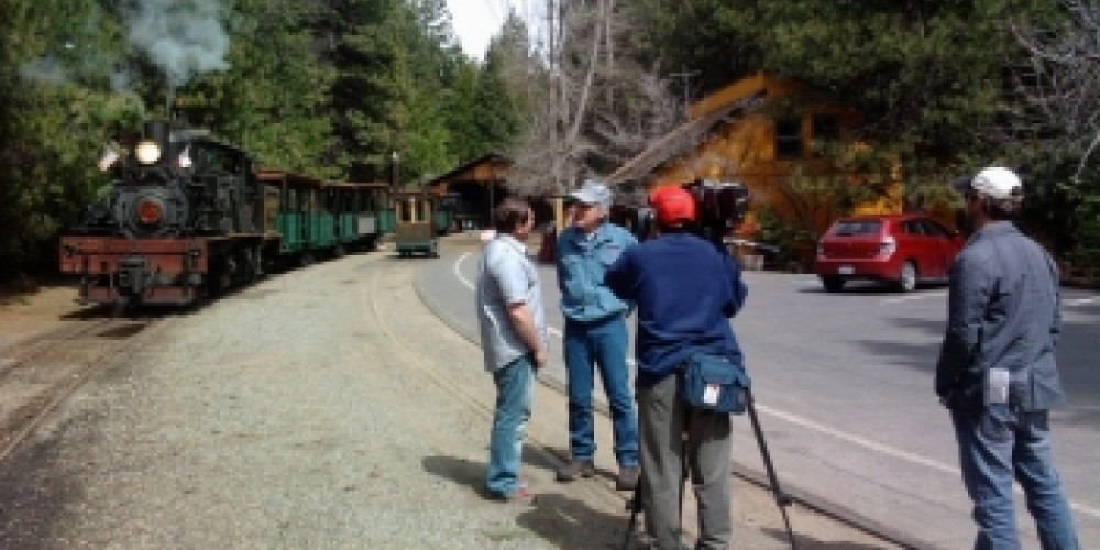 Sugar Pine Railroad owner Max Stauffer is interviewed by a film crew from San Francisco running a story on the historical railroad and museum. – Jarrod Lyman