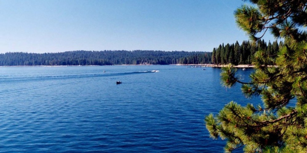 Boaters skim across the calm surface of Shaver Lake. – Sue Exline, USDA FS