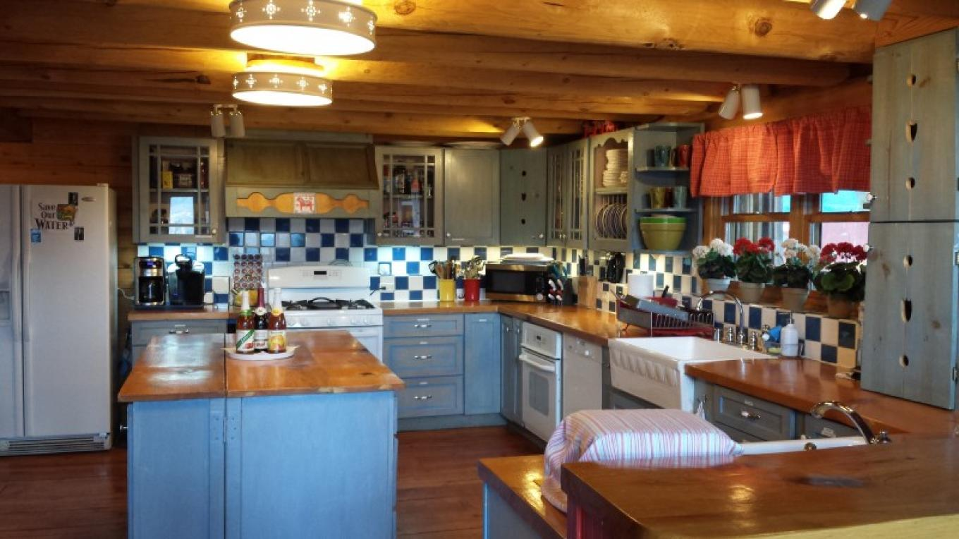 Lillaskog has a large, open, well-equipped kitchen. There are 2 refrigerators, 2 ovens and 2 work stations with sinks. The kitchen has all of the pots, pans, dishes and cooking, serving and eating utensils you need! The cabinets are stocked with wine glasses, coffee mugs and drinking glasses. We have plenty of serving platters and bowls to serve your favorite meal in! There is a standard coffee-maker, coffee bean grinder and a Keurig for your coffee needs! All you need to bring is your favorite food and beverages!