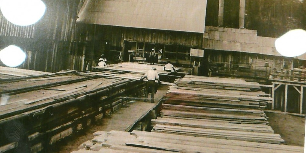 Vintage lumber mill photo at museum – Unknown