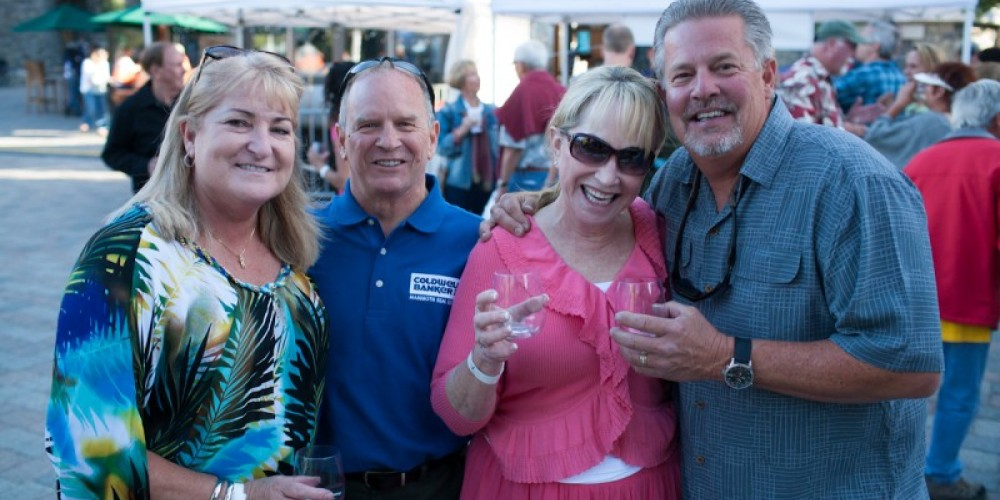 A happy group enjoying the Friday Wine Walk at the Village in Mammoth – Minaret Photography