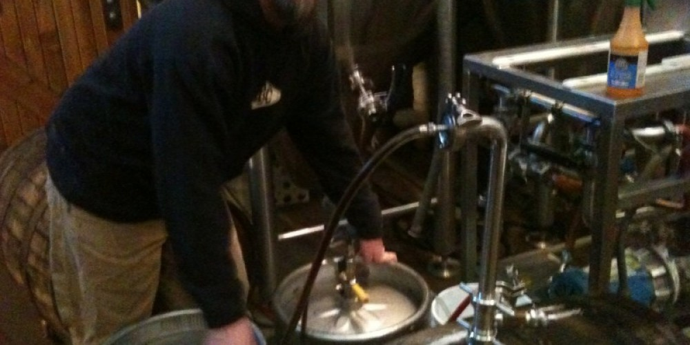 Brewmaster Kyle Smith racking off bourbon stout out of the barrels!