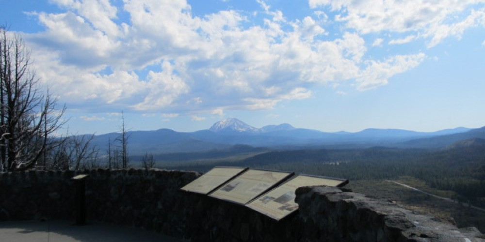 Hat Creek Rim Overlook with clouds – by C. Forster
