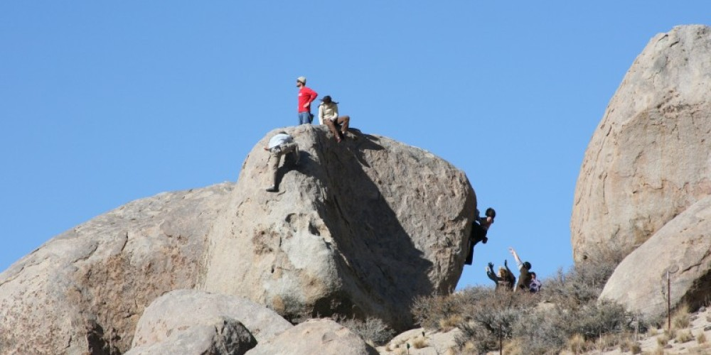 Bouldering in the Buttermilks is most commonly a group rock assault, a pairs and teams encourage climbers. – Julie Faber