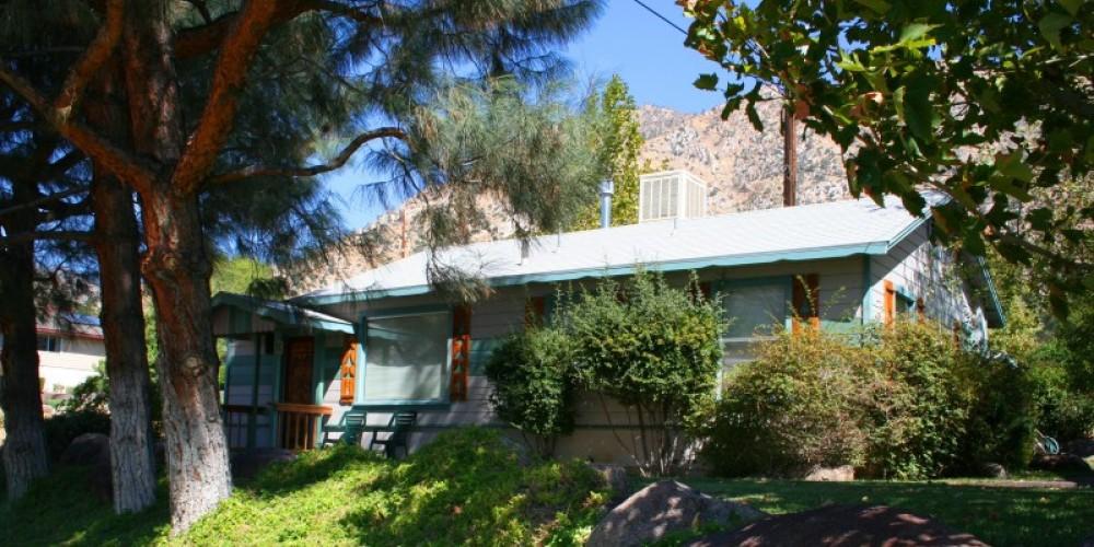 Beautiful greenry, landscaping and native pines surround the cottage property – Jon-Paul Fortunati