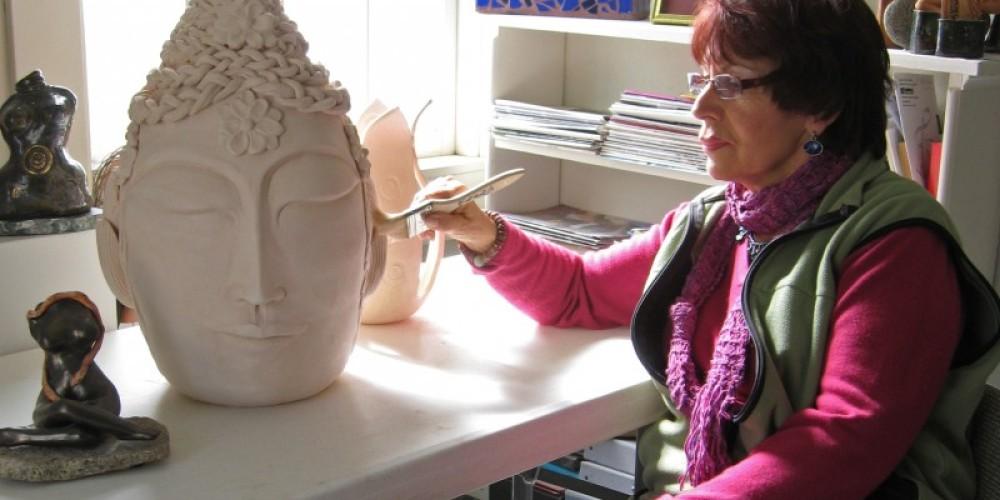 Gerda Francesca glazes clay deity.