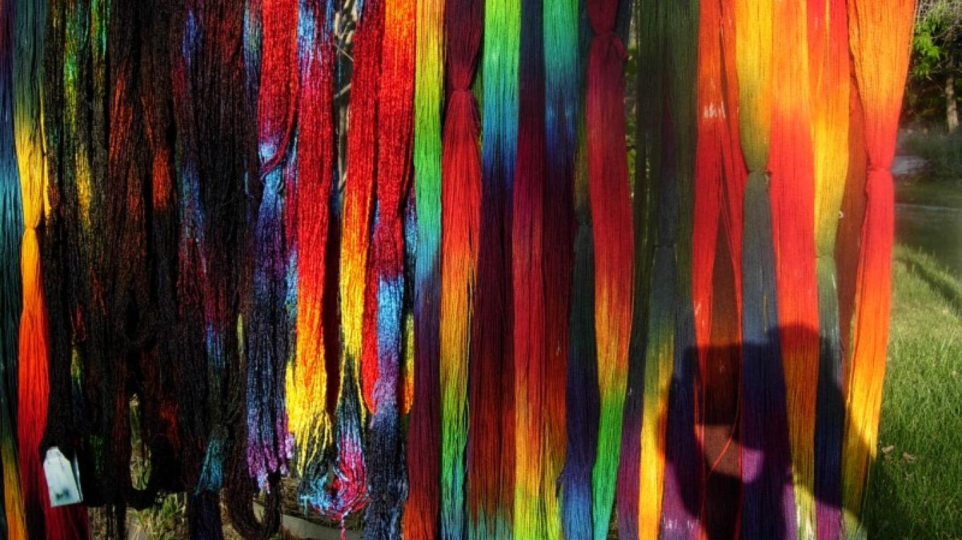Dyed warp chains drying in the sun – Nikki Crain