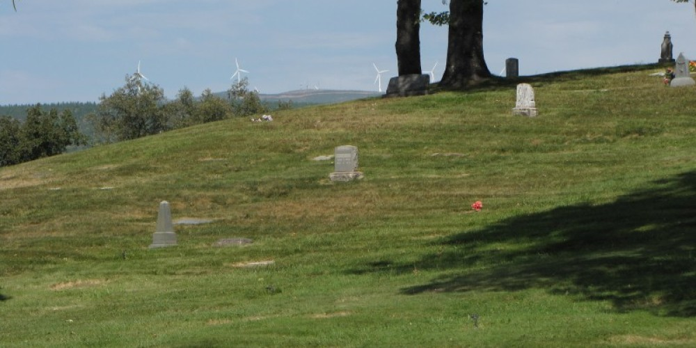 Halcumb Cemetery with the Hatchet Ridge windmills beyond. – Ben Miles