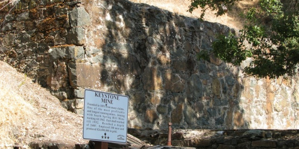 Some of the original foundations of the gold processing stamp mill are easily seen. – Karrie Lindsay