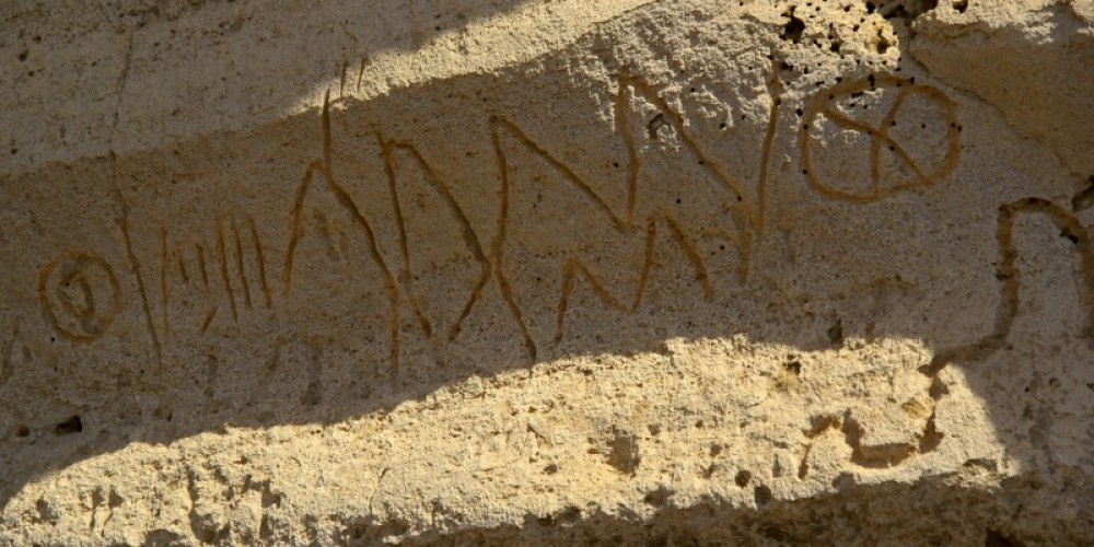 Petroglyphs at Petroglyph point. The Modoc people carved several scenes in the rock – Lorisa Soriano