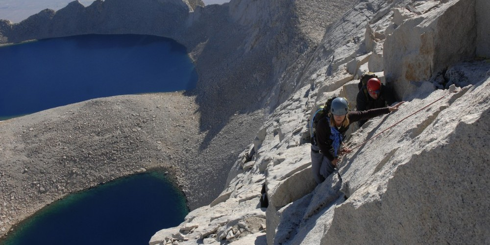 Climbers high on Mt. Russell\'s spectacular East Ridge.  Below is Lake Tuleinyo, the highest lake in the Western Hemisphere. – Kurt Wedberg