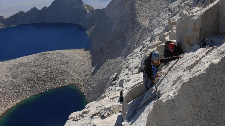 Climbers high on Mt. Russell\'s spectacular East Ridge.  Below is Lake Tuleinyo, the highest lake in the Western Hemisphere. – Kurt Wedberg