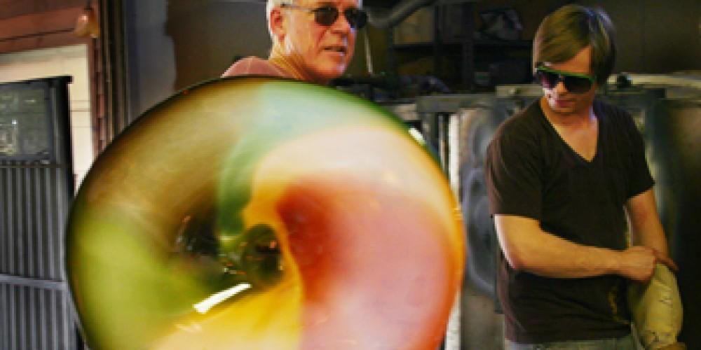 Rick Nicholson and Matt Eaton finishing a molten glass platter – Janet Nicholosn