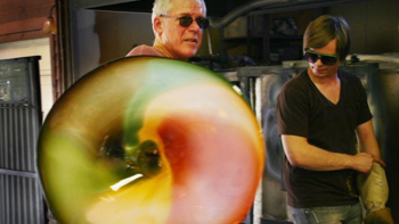 Rick Nicholson and Matt Eaton finishing a molten glass platter – Janet Nicholosn