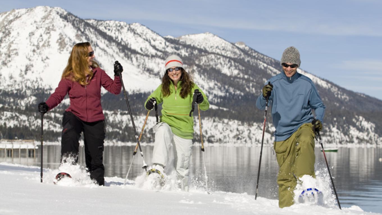 Snowshoeing along the lakeshore – Camp Richardson Resort