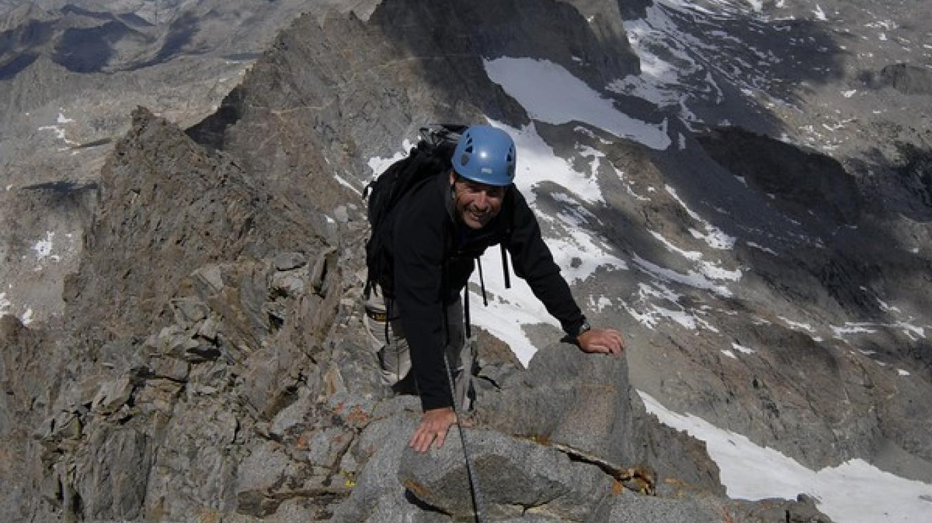 Climber high on Norman Clyde Peak (13, 986\', 4263m) named after the famous pioneer of Sierra Mountaineering. – Kurt Wedberg