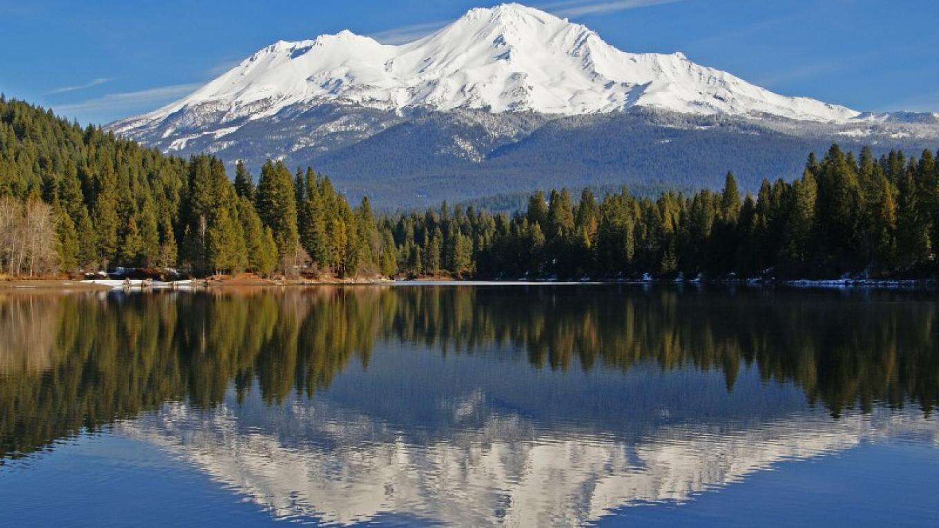 Mount Shasta reflected in Lake Siskiyou, Mt. Shasta, California. – David Sjosedt