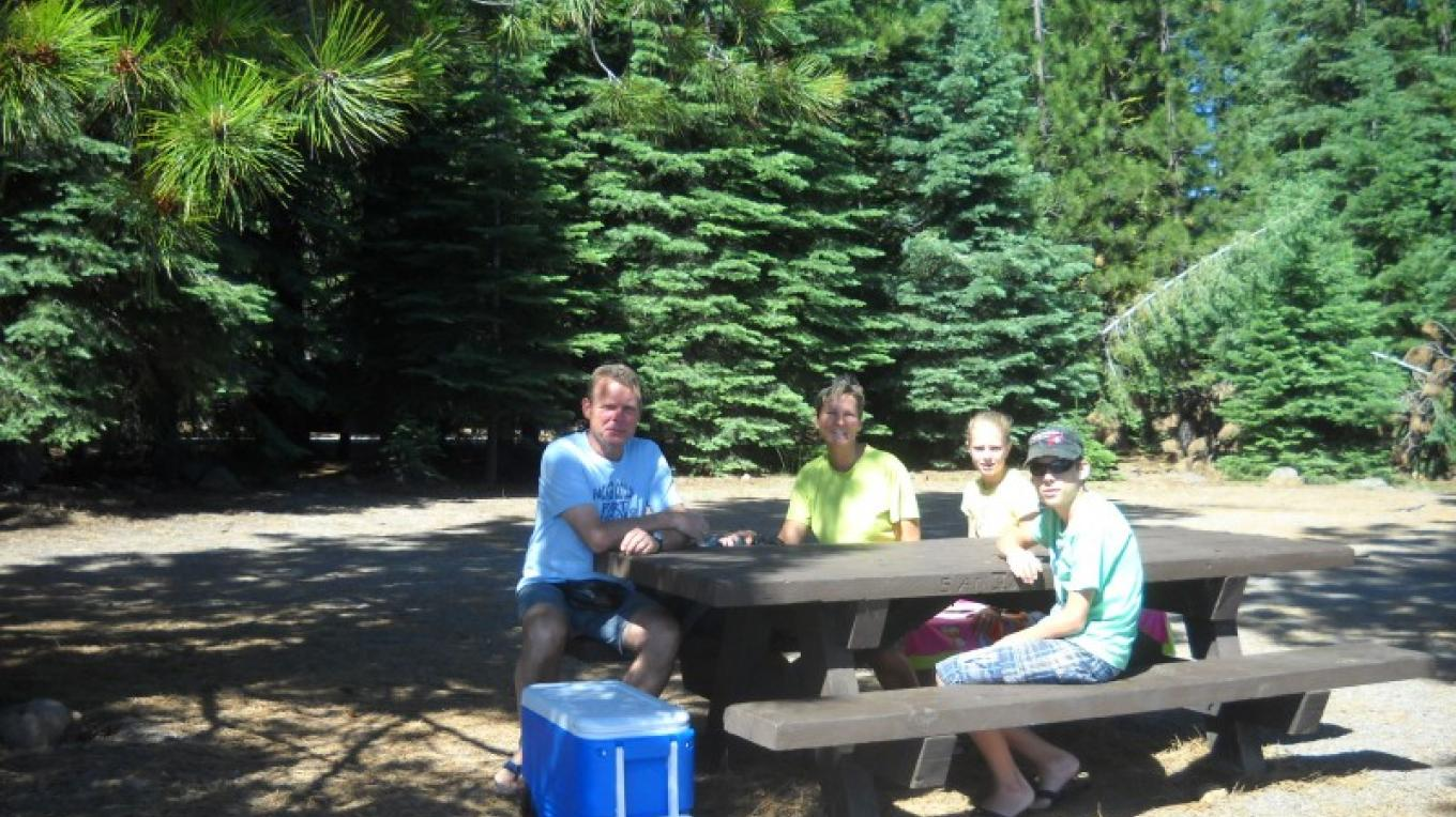 Visitor from Germany picnicking on the Lake Almanor. – Volcanic Legacy