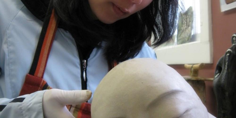 Thien Dao working on clay deity series.