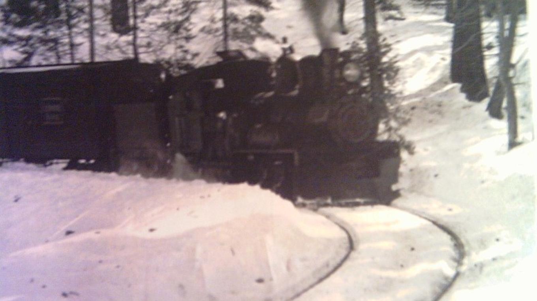 SJ&E heading downgrade in the snow near Shaver Crossing Station