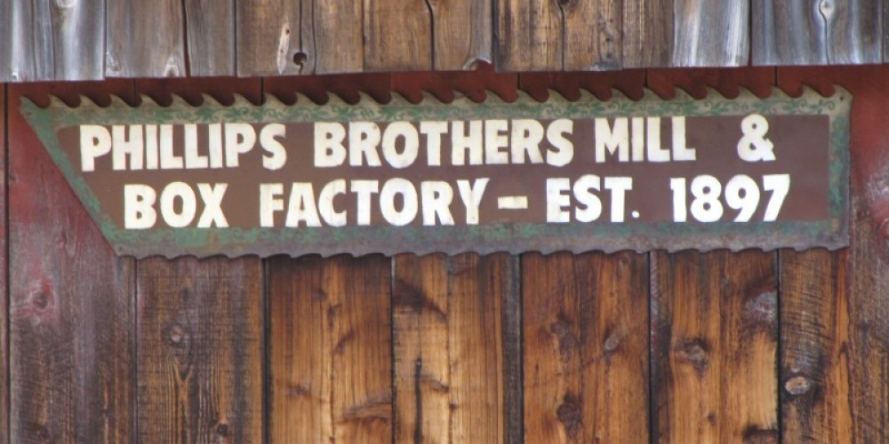 Sign on steam-powered box factory at the Phillips Brothers Mill. – Ben Miles