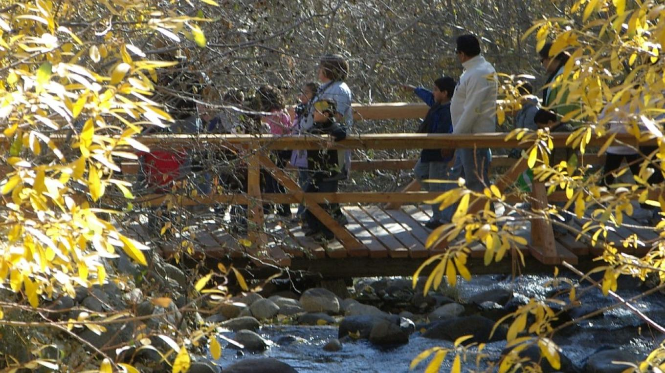 Family crossing Galena Creek on Nature Trail at Galena Creek Regional Park – Bob Harmon, Washoe County Regional Parks & Open Space