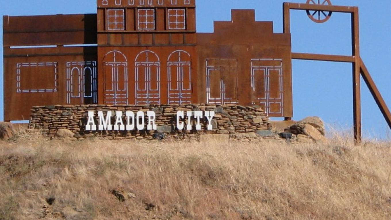 The outline replica of key structures in Amador City is lit by solar power. It welcomes all those driving south on Highway 49. – Karrie Lindsay