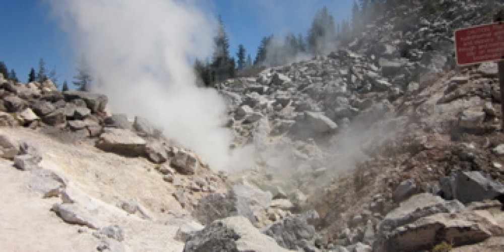 Fumaroles, or steam vents, billow forth from the rocky landscape. – Leah Duran
