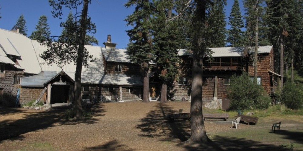 Clair Tappaan Lodge north entrance facing the meadow, summer – Joel Brody