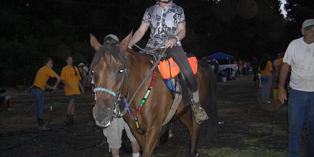 Tevis rider heading into the canyon at night – Debbie Griffin
