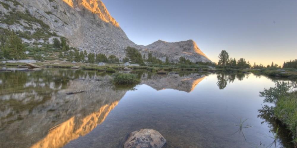 Alpenglow reflections of Vogelsang & Fletcher Peaks.