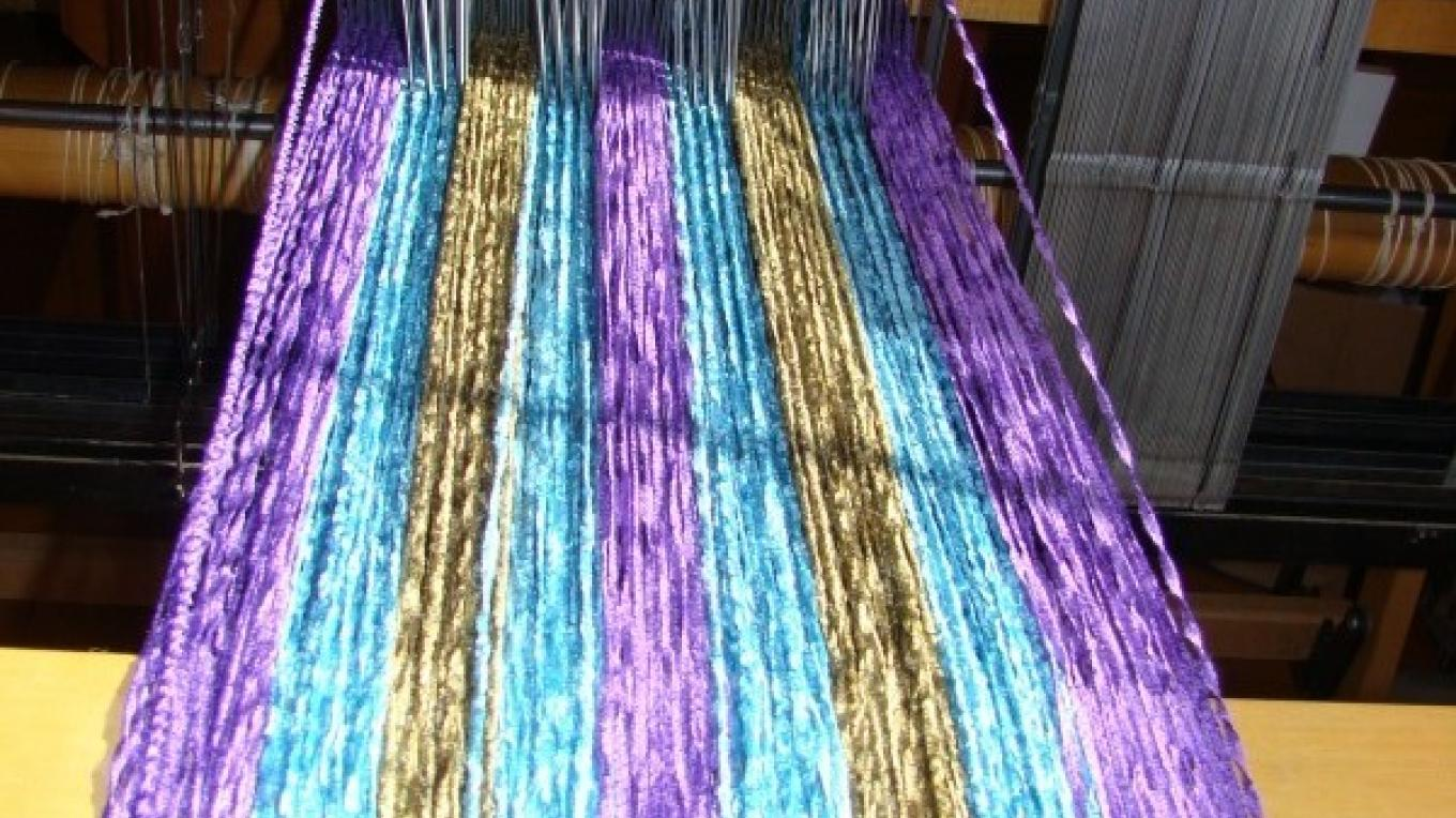 Floor looms are in constant use creating beautiful rugs. – Jean Bilodeaux