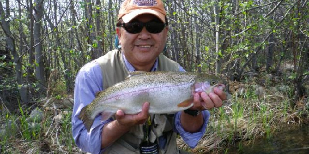 Client Chiaki Harami with a nice Kern River Rainbow he caught and released on the upper Kern River – Guy Jeans